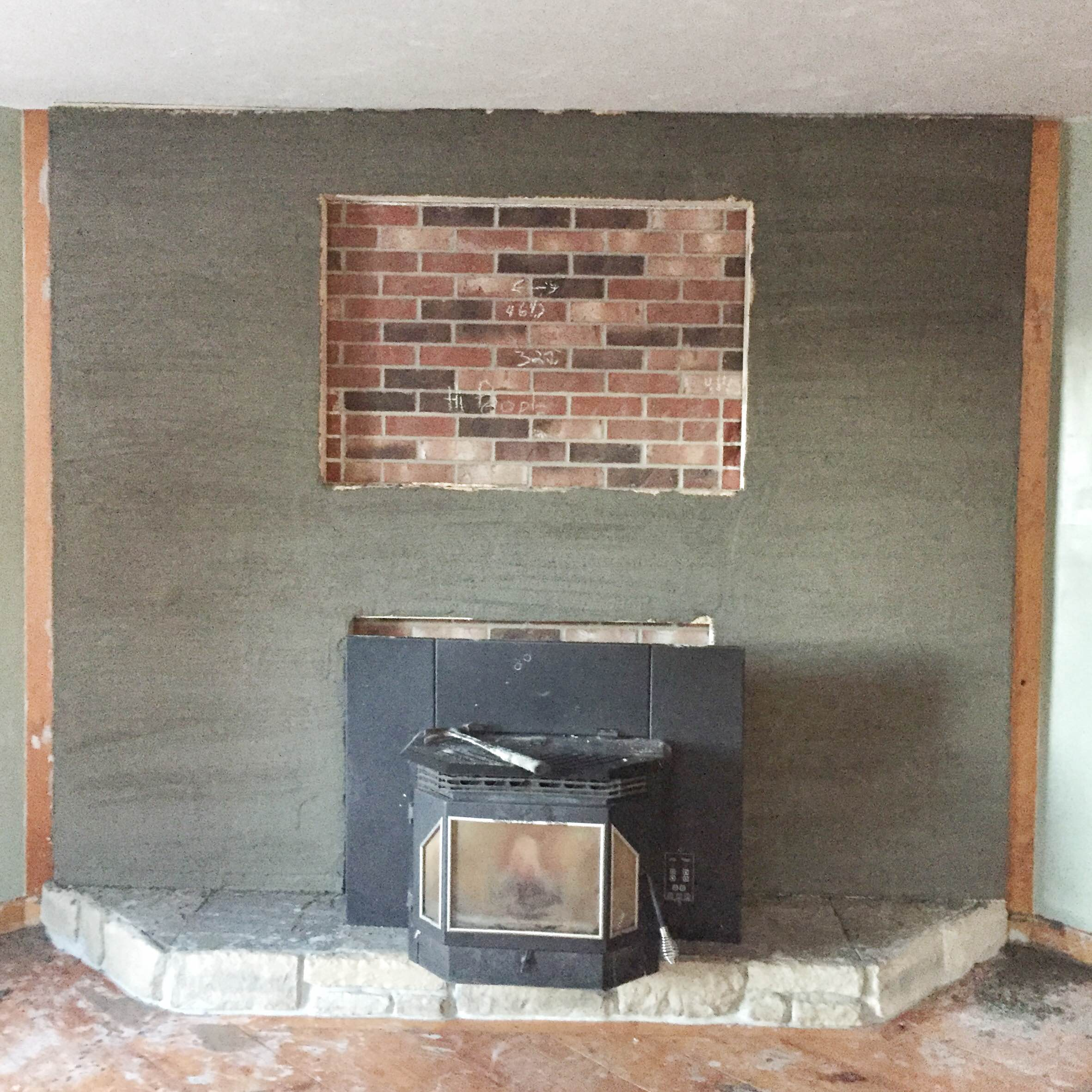 Brick fireplace makeover | Brick to stone veneer fireplace makeover | How to do a stone veneer fire place | GinaKirk.com